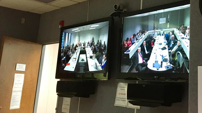 Video monitors of commission meeting