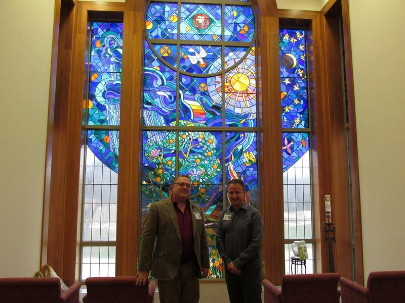 Dan Frachey (L) & Brian Blasco in front of a stained glass window in the Chiara Center