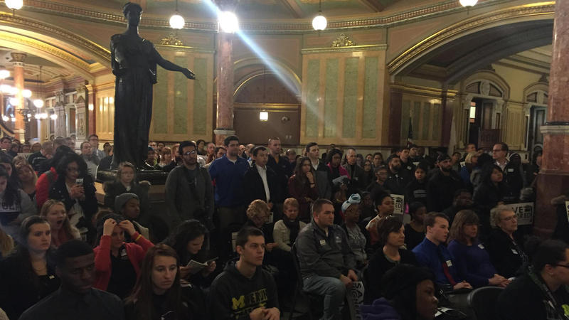 Student rally in Illinois state capitol rotunda.