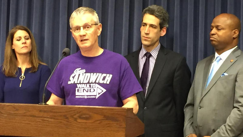 "Jerry Rabbe, whose mother was kicked out of several nursing homes. Behind (l-r), Jamie Freschi, State Sen. Daniel Biss (D-Evantston), State Rep. Emanuel ""Chris"" Welch (D-Hillside)."