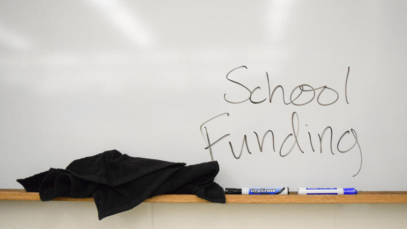 "White board with, ""School Funding"" written on it"