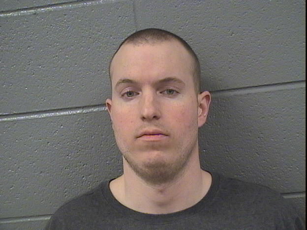 Stuart A. Wright, 32, pleaded not guilty to a hate crime charge. Prosecutors contend that he smashed a window and pasted swastika stickers at the entrance of a Chicago synagogue.