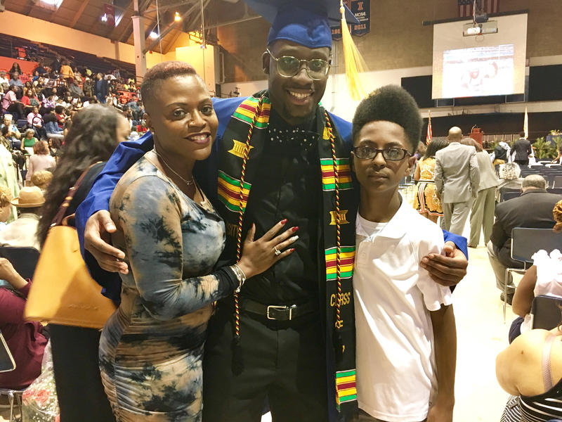 Dashawn Julion (center) poses with his mother, Leisha Julion, and his 13-year-old brother Larry at the Black Congratulatory ceremony.