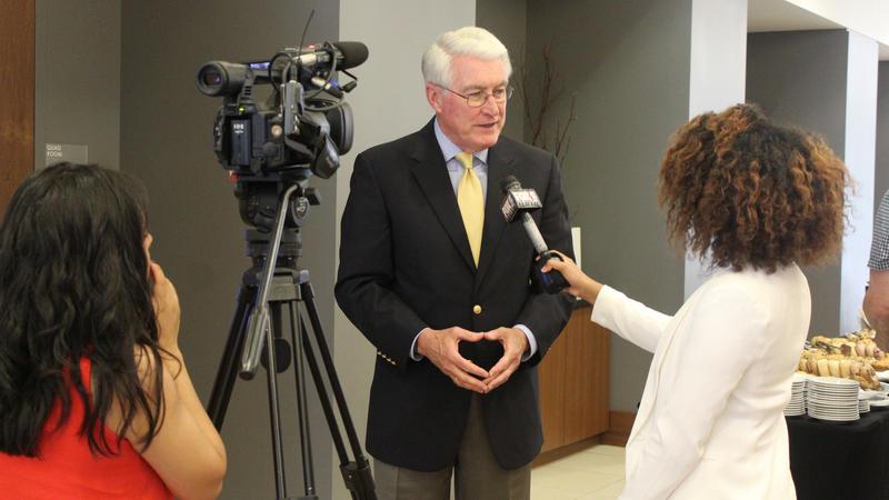 Governor Jim Edgar discusses the forum with Senait Gebregiorgis of WCCU.