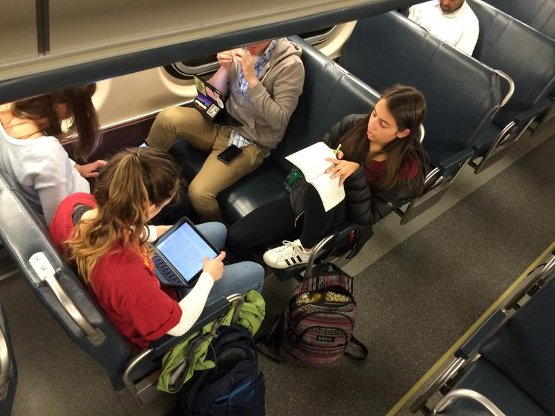 New Trier students got their school work done while en route to Springfield, thanks to their iPads.