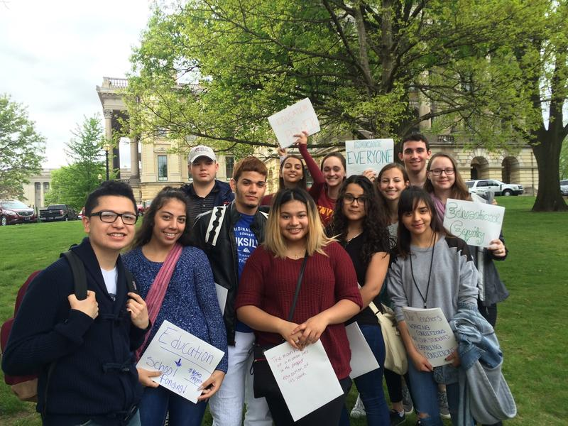 Students with Metropolitan Community Project pose in front of the Illinois capitol.