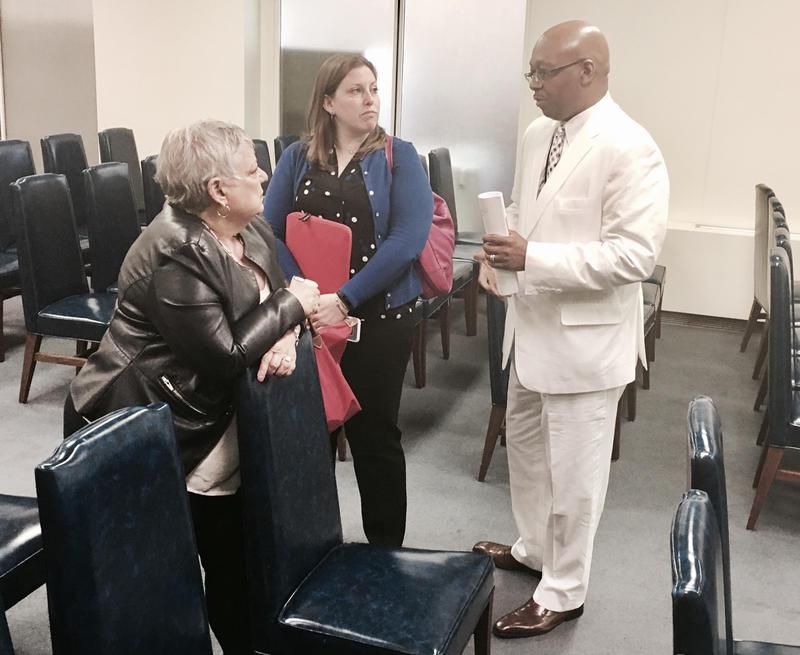 Davis chatting with advocates