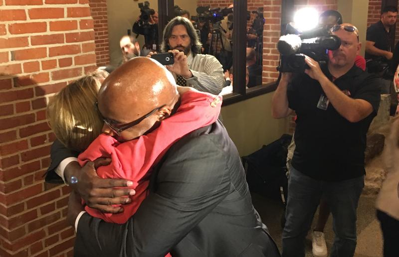 Kwame Raoul and Christine Radogno hug