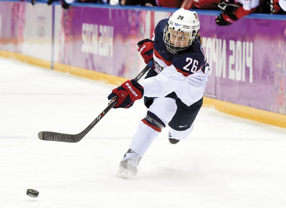 Kendall Coyne at the 2014 Sochi Winter Olympics. Coyne and  her fellow U.S. Women's Hockey Team members planned to boycott the world championships over a pay equity dispute, but a settlement was reached prior. The U.S. team won the championship.