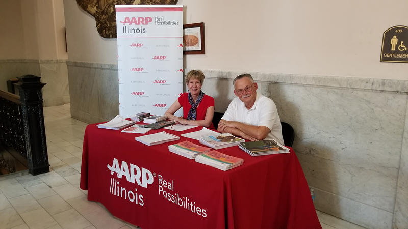 Volunteers provide information from our sponsor, AARP Illinois.