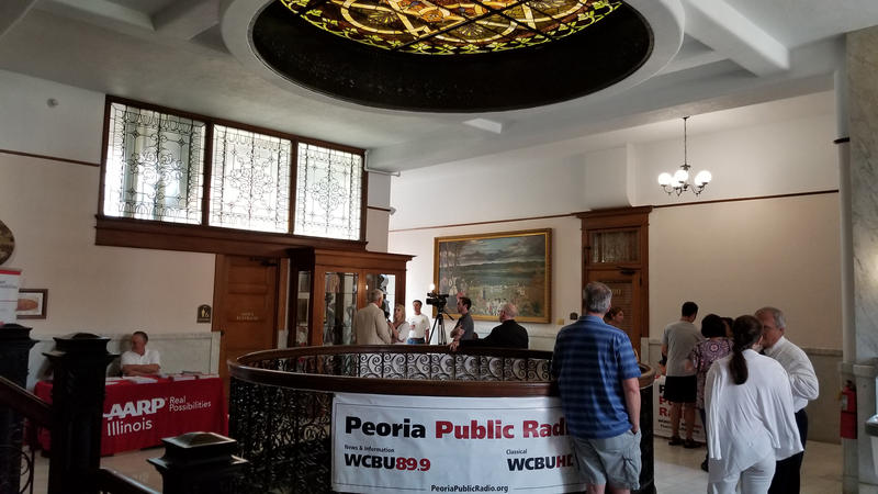 Media interviews and registration in the Peoria City Hall atrium.