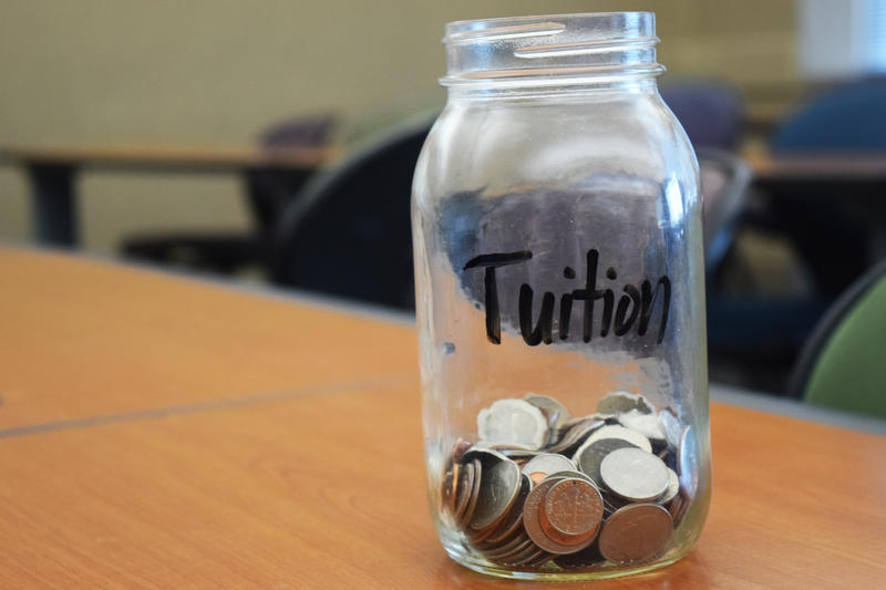 Mason jar with coins in bottom.