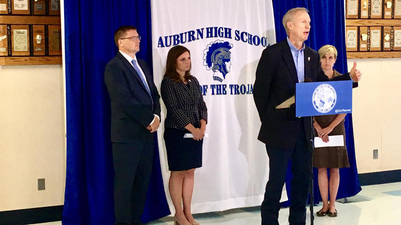 Gov. Bruce Rauner, flanked by Auburn superintendent Darren Root, State Representatives Avery Bourne (R-Raymond) and Sara Wojcicki Jimenez (R-Leland Grove), demands SB1 by Monday at noon.