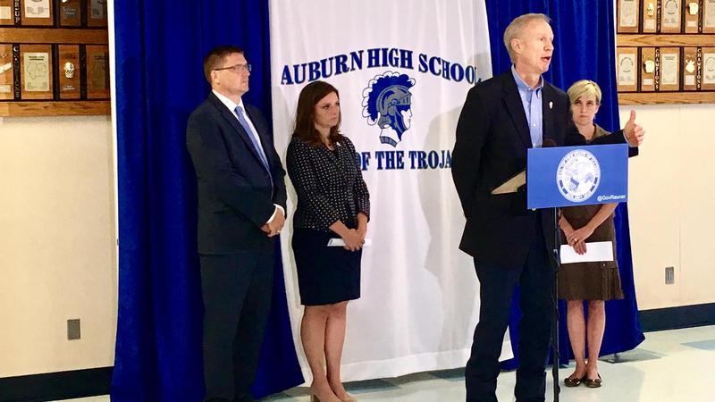 Gov. Bruce Rauner, flanked by Auburn superintendent Darren Root, State Representatives Avery Bourne (R-Raymond) and Sara Wojcicki Jimenez (R-Leland Grove), demands SB1 by Monday at noon.