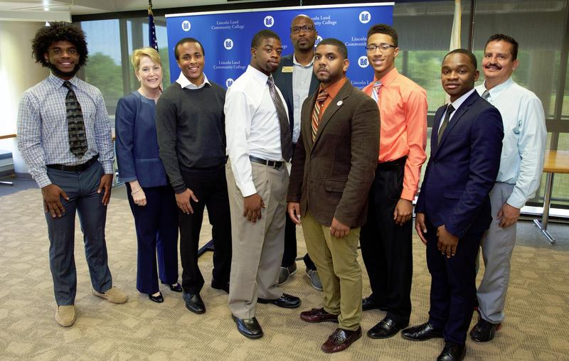 Several members of the Open Door Mentorship Program at Lincoln Land Community College pose with the program's coordinator, Michael Phelon (center, back) and president Dr. Charlotte Warren.