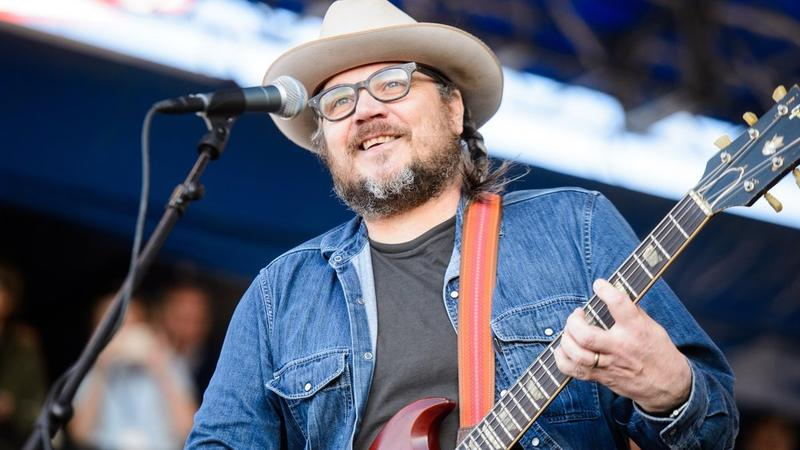Jeff Tweedy playing guitar on stage