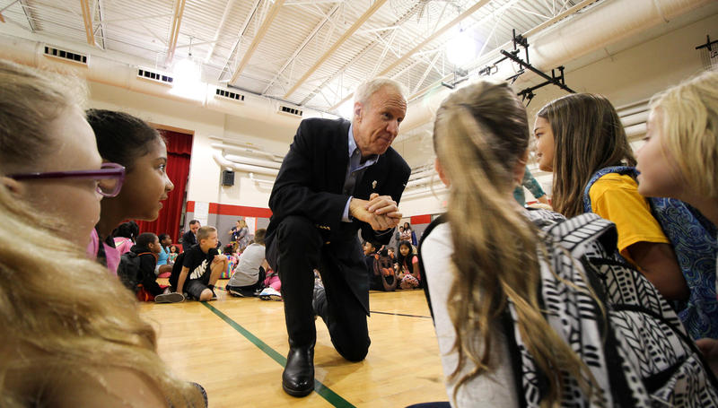 Gov. Bruce Rauner chats with students at Ball Charter School in Springfield as he celebrates approval of a new school funding plan.