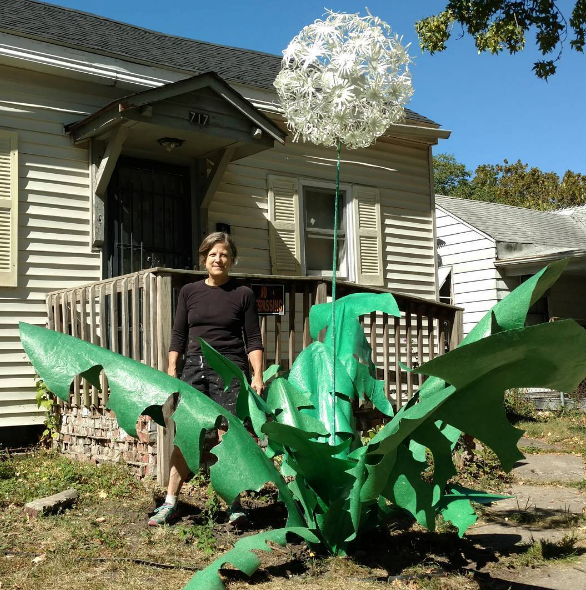 Springfield Art Association Executive Director Betsy Dollar stands by her near complete work