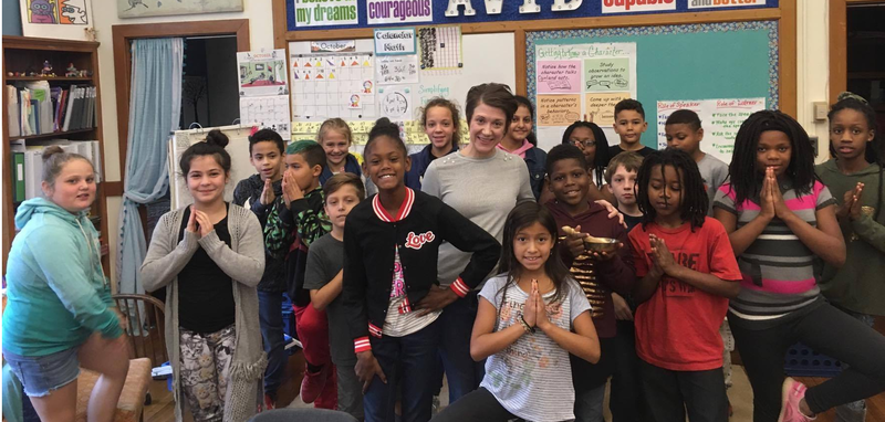 instructor Ashley Krstulovich surrounded by a 5th grade class at Butler Elementary School