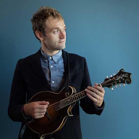 Chris Thile playing mandolin