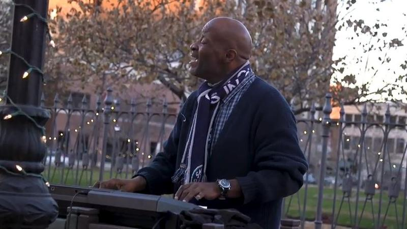 DJ Johnson plays on the Old State Capitol Plaza