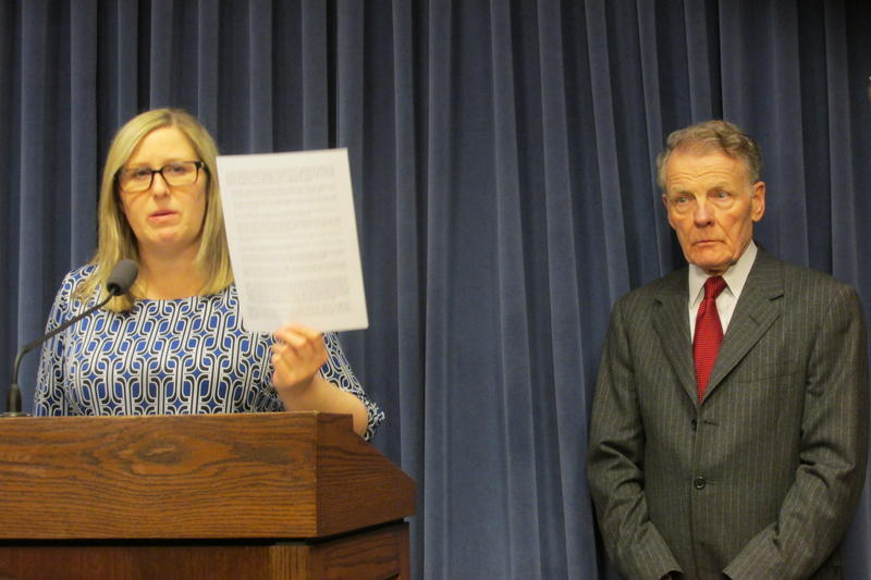 Heather Wier-Vaught, attorney for the Speaker, presents the list of complaints to reporters at a press conference while House Speaker Michael Madigan looks on. Both addressed media questions at the press conference on Feb. 27