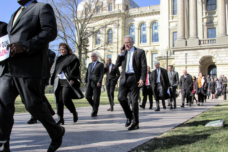 State senators staged a brief walk-out Wednesday morning, in solidarity with schoolkids across the country calling for stricter gun control.