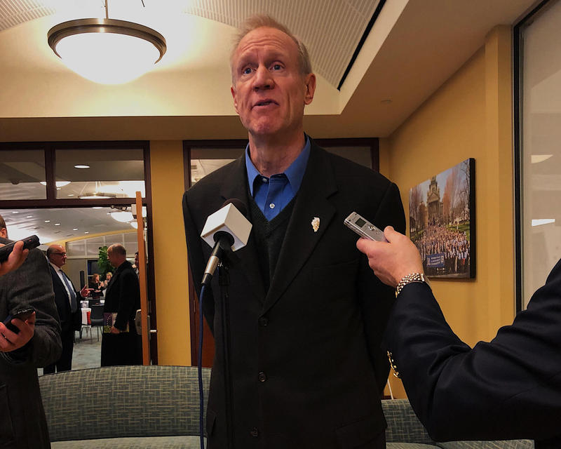 Gov. Bruce Rauner answers media questions at a bicentennial event in Springfield on Feb. 6.