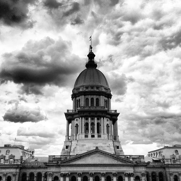 Illinois statehouse with storm clouds in the background