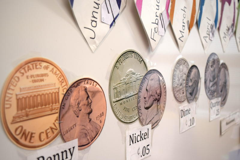 Coins cutout and posted on bulletin board
