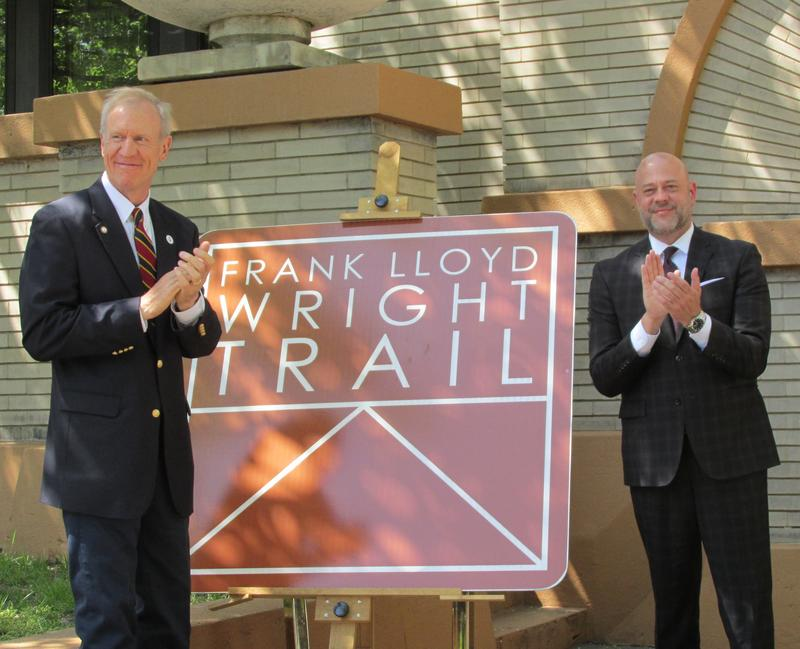 Illinois Office of Tourism Director Cory Jobe unveils official signage for the trail alongside Gov. Bruce Rauner at an event outside Springfield's Dana-Thomas House on May 8.