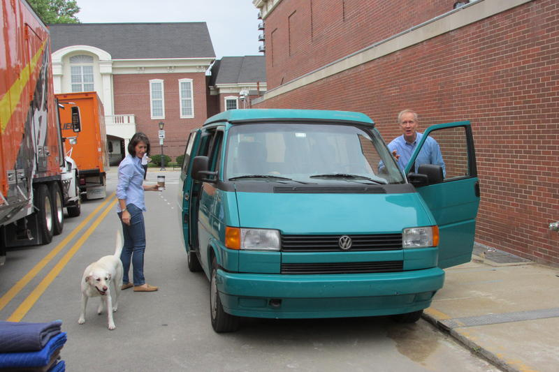 Gov. Rauner, First Lady Diana Rauner and their dog, Stella, begin unpacking the moving van outside the Governor's Mansion in Springfield