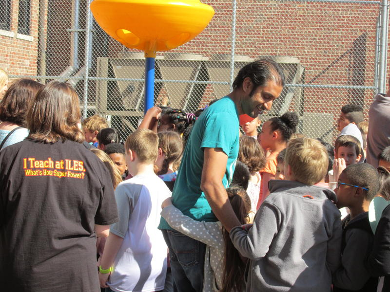 "Nimesh Patel - ""Nimo"", hugs and high-fives students after a ""kindness march"" around the school"