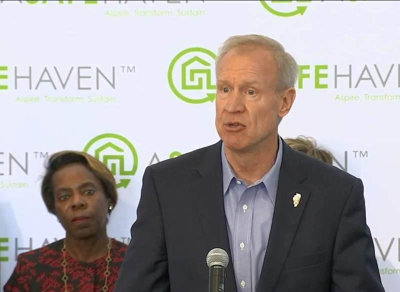 Gov. Bruce Rauner announces the new program at an event in Chicago on May 7, while HFS Director Felicia Norwood, left, looks on.