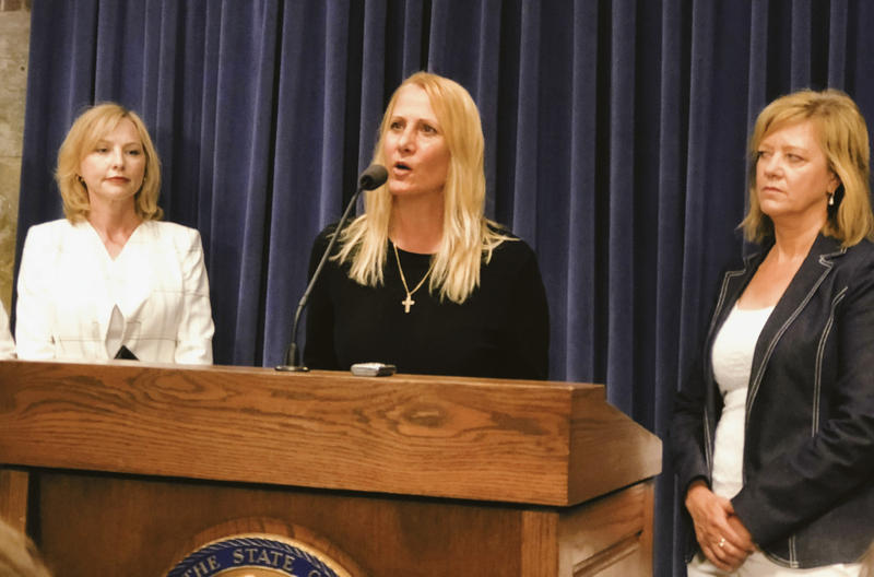 Maryann Loncar (center) claims state Rep. Lou Lang (D-Skokie)  inappropriately touched her and threatened her.  Denise Rotheimer (left) and Rep. Jeanne Ives (right).