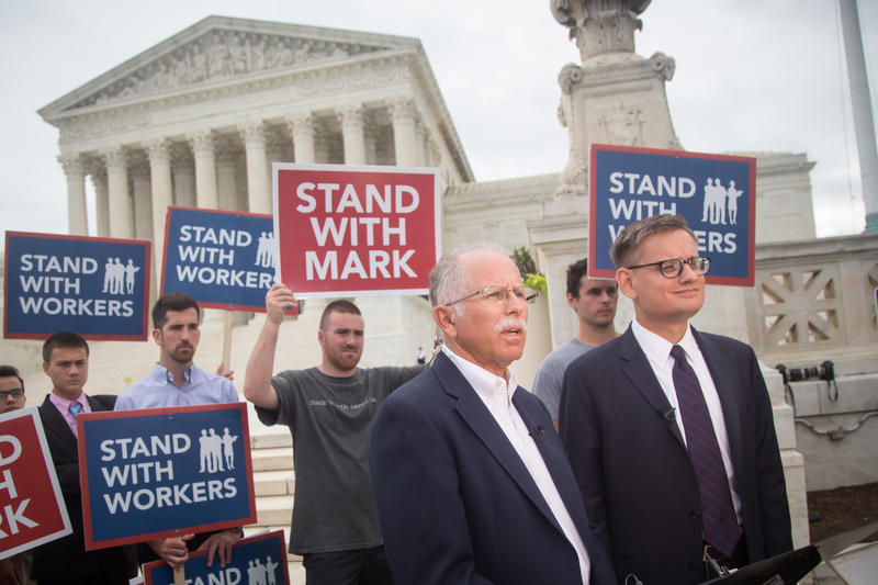 Mark Janus  (left) and his attorney Jacob Huebert, director of litigation with the Liberty Justice Center -- brief media at the steps of the U.S. Supreme Court building after SCOTUS decision.