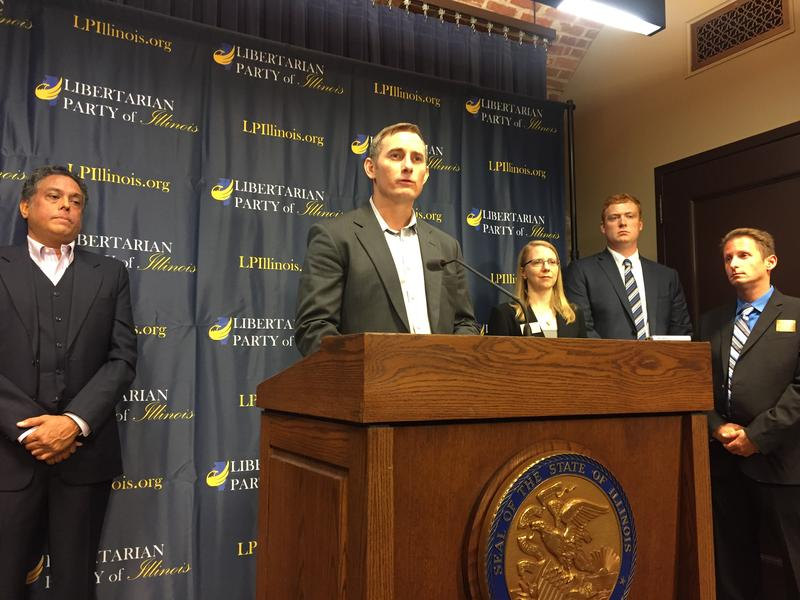 Kash Jackson speaks at a press conference on Monday. Standing behind him are other Libertarian candidates for Illinois.