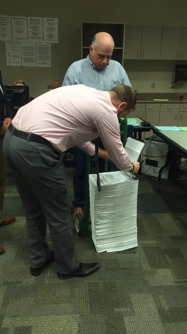 Senator Sam McCann files roughly 65,000 petition signatures to get on the fall ballot.