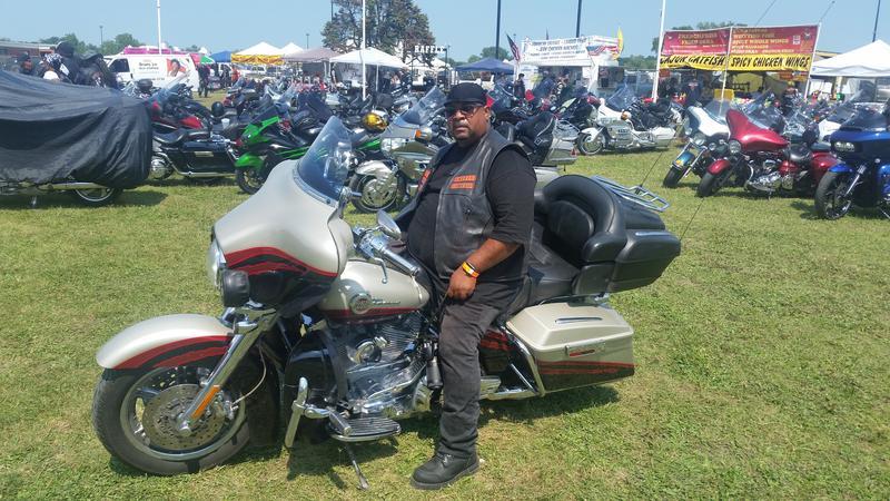 Cool Metal sits on his bike