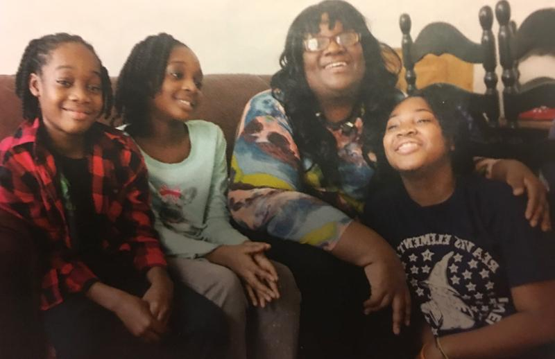 Maxica Williams, seen with three of her children, appeared before a state legislative committee to speak to the need for an increase financial help for needy families.