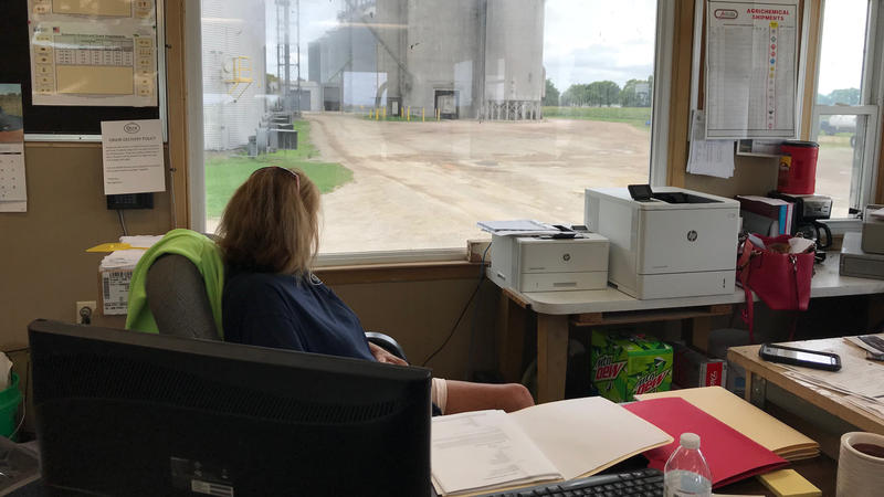 Shelley Martina waits for a truck loading corn at the grain elevator in Lovington, Illinois.