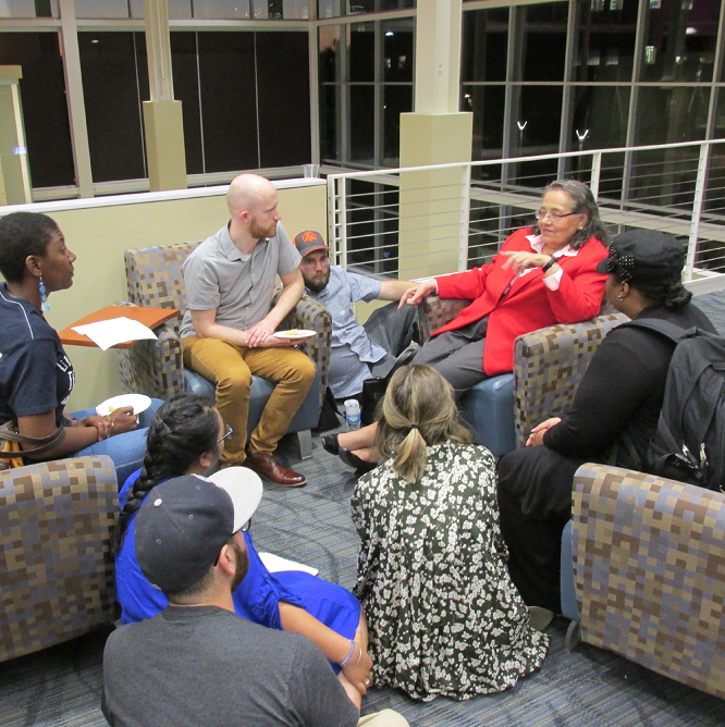 Diane Nash, in red, speaks with a group of students and teachers at the UIS student union following her official remarks
