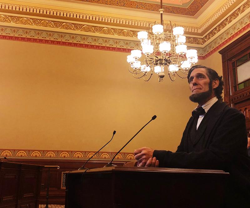An Abraham Lincoln impersonator opens testinomy during a House hearing for the Lincoln museum foundation .