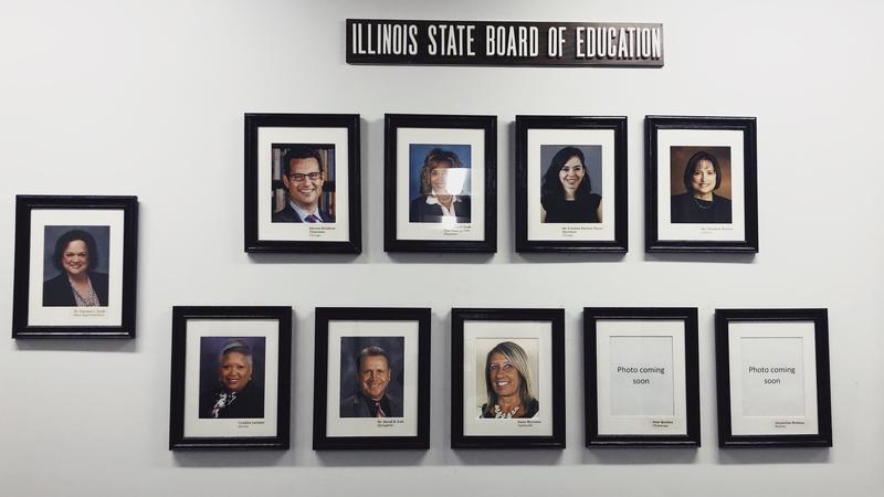 Wall of framed board member head shots