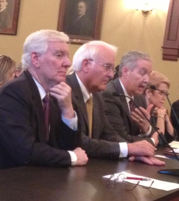 SIU President Glenn Poshard, left, and U of I President Robert Easter, center, testify at a House hearing Thursday on the pension cost shift.