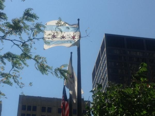 In downtown Chicago, the city's flag and the state flag fly side-by-side.  Gov. Quinn's office says he lives in both Chicago and in the capital city.