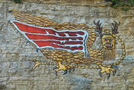 This later painting is visible on bluffs along the Mississippi River at Alton.