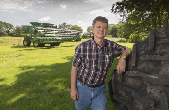 Mark Crawford stands at his farm near Danville, Ill. Crawford, who grows corn, soybeans and wheat on his large farm, said the crop insurance programs are important parts of the risk-management safety net for farmers. (Darrell Hoemann/Midwest Center for Investigative Reporting)