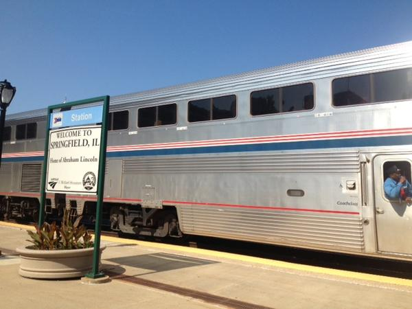 An Amtrak train stops to drop off and pick up passengers at the Springfield station.