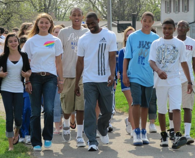 Olympian Tyson Gay walked with students outside Beaumont Middle School to kick off the 2010 World Fit program.